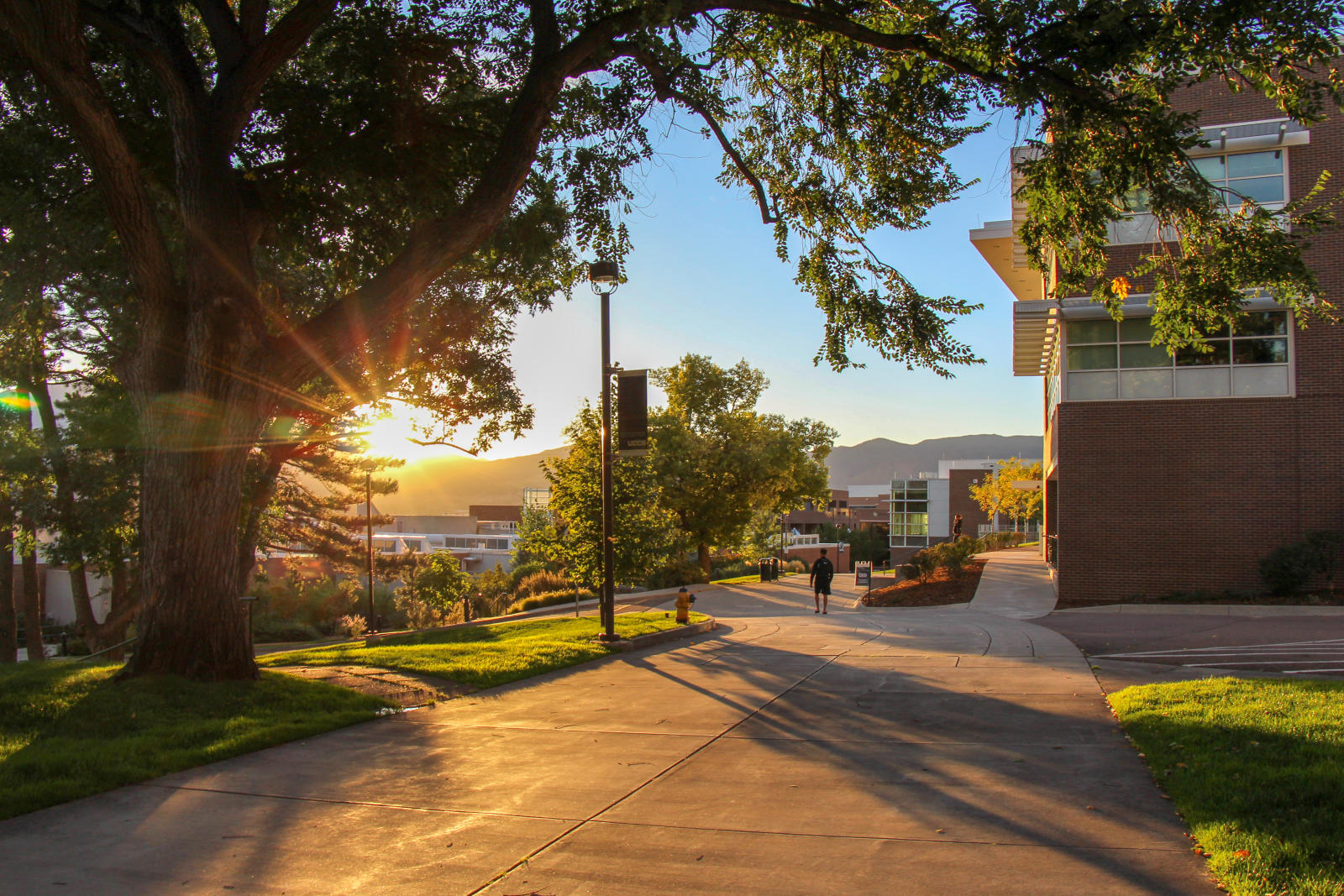 Sunsetting behind mountains near Dwire Hall